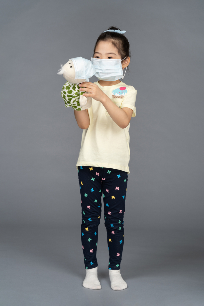 child in face mask photo