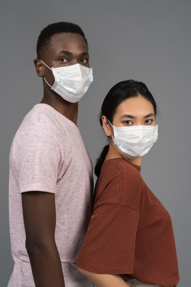 people in masks stock photo