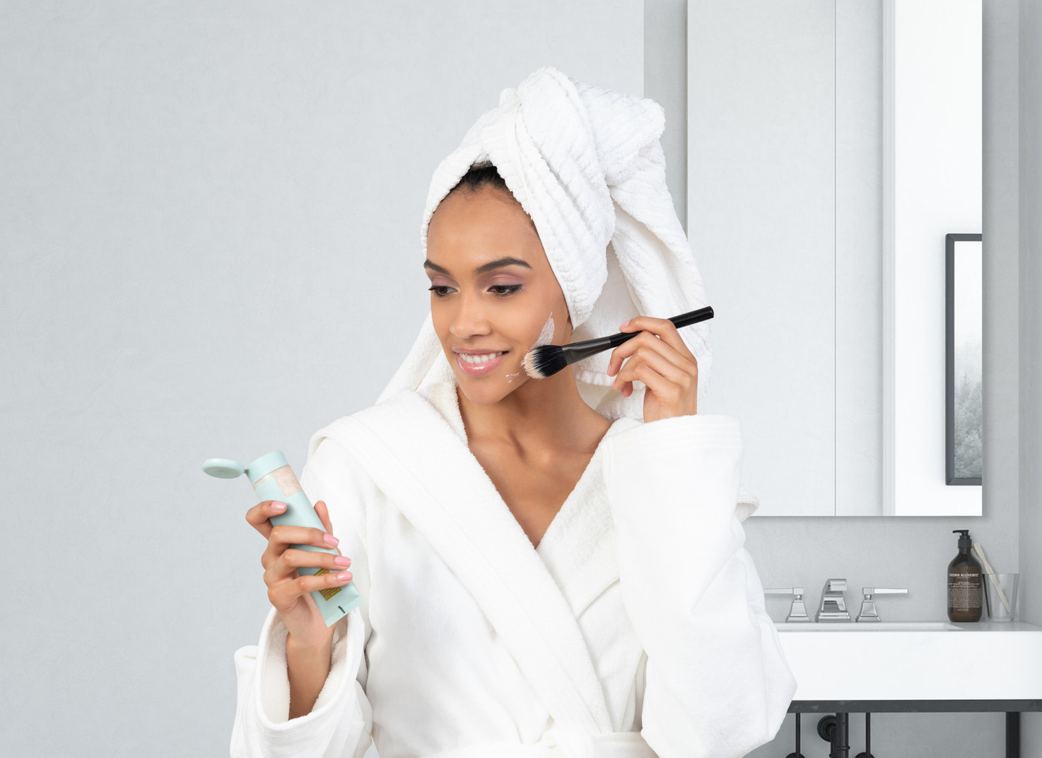 Why Photography and Videography Matter for Your Website: woman in robe takes morning bath and makeup